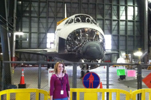 Alumni, Eve Halligan, with the Space Shuttle Endeavor as  it is decommissioned at the Kennedy Space Center.