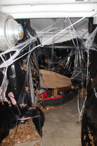 Noehren Hall decorated with Spider Webs and Caskets for the Annual Haunted House Fundraiser.