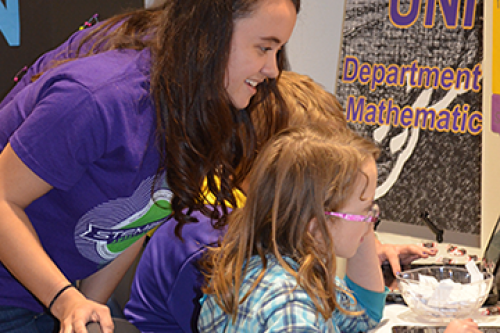 UNI Math Majors help at a regional STEM Festival.