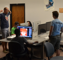 Camp Director checking in with Digital Storytelling Campers during project free work time.