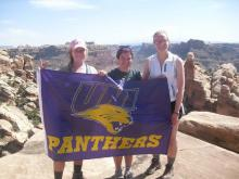 Kara and fellow UNI students pose with the UNI Flag while on Colorado River Rafting trip.