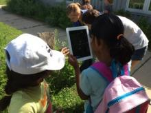 Exploring the Tall Grass Prairie through Art and Science Campers document their discoveries using hand held devices.