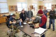 Students problem solving in lab.