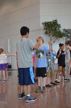 Scientific Thought and Motion campers mirror each others movements in this dance skills development game.
